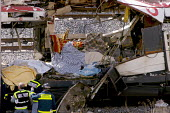 Police looking at the wreckage after the terrorist bombing of commuter trains on the morning of 11 March 2004, between Alcala de Henares and Atocha station in Madrid, which killed 191 people and wound... - Mario Fourmy - 11-03-2004