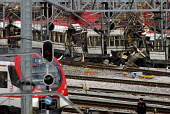 The wreckage after the terrorist bombing of commuter trains on the morning of 11 March 2004, between Alcal de Henares and Atocha station in Madrid, which killed 191 people and wounded over 1700. A gro... - Mario Fourmy - 11-03-2004