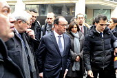 President Francois Hollande, accompanied by Bernard Cazeneuve, Minister of the Interior and Anne Hidalgo, mayor of Paris arrive at the scene of the shootings in the attack on the Charlie Hebdo offices... - Pascal Sittler - 07-01-2015