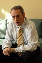 John Hutton MP speaking to a Daily Telegraph journalist, Whitehall, London - Rogan Macdonald - 25-05-2006