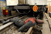 A dummy in front of a stationary underground carriage used by the Emergency Response Unit (ERU) to simulate emergency routines. The ERU works in conjunction with the emergency services in responding t... - Rogan Macdonald - (ERU),2000s,2006,adult,adults,bodies,body,carriage,carriages,cities,city,communicating,communication,Crash,dia accident accidents,dummies,dummy,Emergency,fire brigade,firefighter,firefighters,fireman,