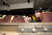 Emergency Response Unit (ERU) and firefighters practise removing a person from under a train. The ERU works in conjunction with the emergency services in responding to derailments and accidents on the... - Rogan Macdonald - 30-05-2006