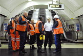 Emergency Response Unit (ERU) talking London Underground staff before entering the tunnel at Warren Street Underground Station, London. The ERU works in conjunction with the emergency services in resp... - Rogan Macdonald - 06-06-2006