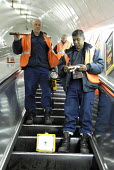 Emergency Response Unit (ERU) on the escalator at Warren Street Underground Station in order to repair a rail. The ERU works in conjunction with the emergency services in responding to derailments and... - Rogan Macdonald - 06-06-2006