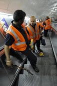 The Emergency Response Unit (ERU) return to the surface after repairing a rail at Warren Street Underground Station, London. The ERU works in conjunction with the emergency services in responding to d... - Rogan Macdonald - 05-06-2006