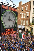 Italian football fans living in London, watch the World Cup Final outside Bar Italia in Soho, central London. - Rogan Macdonald - 09-07-2006
