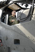An Italian pilot sitting in the cockpit of an A-129c Mangusta, at Farnborough International Airshow in Hampshire, U.K. - Rogan Macdonald - 14-07-2006