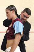 A doctor examines boxer Shanee Martin before a fight British Masters Female Super Flyweight Title, Goresbrook Leisure Centre in Dagenham, London - Rogan Macdonald - 23-07-2006