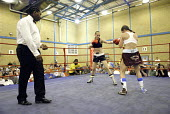 Woman boxer Shanee Martin (white top) fighting Juliette Winters (black top) for the British Masters Female Super Flyweight Title, At Goresbrook Leisure Centre in Dagenham, London. - Rogan Macdonald - 23-07-2006