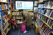 A mother and son select books at a mobile library, run by the London Borough of Lambeth in Streatham, South London - Rogan Macdonald - 18-01-2007