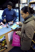 A woman gets some books and DVDs out at a mobile library, run by the London Borough of Lambeth in Streatham, South London - Rogan Macdonald - 18-01-2007