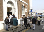 Men leave the Brick Lane Mosque (Jamme Masjid) in East End of London. - Rogan Macdonald - 13-04-2007