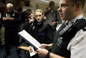 Alan Watson, Area Officer and Ground Commander for the night, briefs members of the Special Constabulary based at Canterbury Police Station before they carry out anti-knife and anti-drug operations, C... - Rogan Macdonald - 07-11-2008