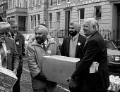 Indian Workers Association (Glasgow branch) show their solidarity with the miners by donating 1,200 of food for Ayrshire miners & their families. Glasgow, Scotland - Rick Matthews - ,1980s,1984,asian,asians,BAME,BAMEs,Black,BME,bmes,communities,community,disputes,diversity,donated,donating,donation,donations,ethnic,ethnicity,food,FOODS,Glasgow,Indian,INDUSTRIAL DISPUTE,member,mem