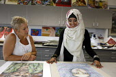 Teacher and student in an A level Art class at Joseph Chamberlain Sixth Form College. - Roy Peters - ,2010s,2011,6th form,adolescence,adolescent,adolescents,art,BAME,BAMEs,black,BME,bmes,child,CHILDHOOD,children,cities,city,class,college,COLLEGES,communicating,communication,cultural,diversity,draw,dr