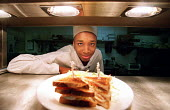 Chef cooking Hyatt Hotel Birmingham - Roy Peters - 2000s,2003,BAME,BAMEs,Birmingham,black,bme,bmes,catering,cities,city,cook,COOKERY,cooking,COOKS,diversity,EBF Economy,ethnicity,food,food preparation,FOODS,gastronomy,good,Hotel,HOTELS,job,jobs,kitche