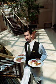 Waiter serving food, Hyatt Hotel Birmingham - Roy Peters - 2000s,2003,asian,at,BAME,BAMEs,Birmingham,black,BME,bmes,cities,city,diversity,EARNINGS,EBF Economy,EQUALITY,ethnic,ethnicity,food,FOODS,gastronomy,good,Hospitality,Hotel,HOTELS,Income,INCOMES,inequal