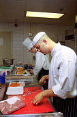 Cooks, Hyatt Hotel Birmingham29 May 2002 - Roy Peters - 2000s,2003,breast,breasts,catering,chicken,CHICKENS,cities,city,cook,COOKERY,cooking,Cooks,EBF Economy,food preparation,Hotel,HOTELS,job,jobs,kitchen,kitchens,lab lbr work,outlet,outlets,people,person
