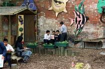 Prince Albert Primary School Birmingham- pupils in the garden playground. - Roy Peters - 2000s,2002,area,asian,BAME,BAMEs,black,BME,bmes,boy,boys,child,CHILDHOOD,children,diversity,edu education,ethnic,ethnicity,garden,GARDENS,junior,juvenile,juveniles,kid,kids,male,minorities,minority,pe