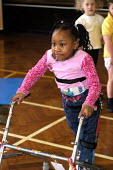 Pupil with a walking frame, Turves Green Primary School - Roy Peters - 13-02-2004