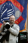 Photographer John Harris in action at a Trades Union rally, Birmingham - Roy Peters - 07-10-2004