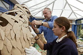 Hall Green School. Art class: outside artist working with year 11 students helping to create huge birds out of cardboard. - Roy Peters - 25-05-2005