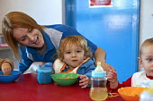 Rachel, Nursery Nurse, Technotots, Kingshurst - Roy Peters - 2000s,2005,care,carer,carers,child,Child Care,childcare,CHILD-CARE,CHILDHOOD,CHILDMINDING,children,class,classroom,CLASSROOMS,CRECH,Creche,CRECHES,EARLY,early years,EARNINGS,eating,edu education,EQUAL