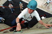 Outward bound course, a project funded by the New Opportunities Fund (now Big Lottery Fund), Mansfield, Notts. - Roy Peters - 2000s,2001,abseiling,achievement,adolescence,adolescent,adolescents,adventure,bound,climber,climbers,climbing,effort,gripping,hard hat,hat,hats,height,life,Lottery,outward,people,person,persons,projec