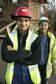 Gurpreet and Jeetinder Singh - Plumbing Cousins - Roy Peters - &,2000s,2002,asian,ASIANS,black,BME Black minority ethnic,build,building site,EBF Economy,hard hat,hats,health,high visibility,jacket,job,jobs,LAB LBR Work,male,man,men,new,people,person,persons,plumb