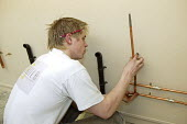 Plumber, apprentice - seen learning his craft at UK Skills Competition, Derby College - Roy Peters - 2000s,2005,adolescence,adolescent,adolescents,apprentice,Apprentices,apprenticeship,building,BUILDINGS,College,COLLEGES,COMPETITATIVE,Competition,craft,edu education,FE,Further Education,Further Educa