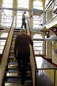 A prisoner going up astaircase, Winson Green Prison, Birmingham - Roy Peters - 27-04-2005