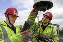 Engineers at work maintaining CCTV camera - Roy Peters - ,2000s,2004,camera,cameras,cctv,checking,CLJ,council services,council services,crime,crime prevention,dome camera,EBF Economy,electrician electricians,ENGINEER,engineer engineers,Engineers,installatio