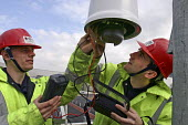 Engineers at work - Roy Peters - 2000s,2004,checking,council services,council services,dome camera,EBF Economy,electrician electricians,employee,employees,Employment,ENGINEER,engineer engineers,Engineers,installation,job,jobs,LBR,LBR
