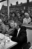 Words of encouragement for Arthur Scargill as he drinks a cup of tea in a cafe after his appearance in court at Rotherham on charges of obstruction - Ray Rising - ,1980s,1984,age,ageing population,appearance,Arthur,cafe,cafes,catering,charges,communities,community,court,disputes,elderly,encouragement,FEMALE,INDUSTRIAL DISPUTE,member,member members,members,Miner