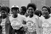 Group of youth at 1979 Notting Hill Carnival London - Ray Rising - 1970s,1979,ACE,Arts,BAME,BAMEs,band,bands,black,BME,bmes,Carnival,Carnivals,cities,City,Culture,dance,dancer,dancers,dancing,diversity,EMOTION,EMOTIONAL,EMOTIONS,ethnic,ethnicity,FEMALE,happiness,happ