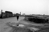 Derelict industrial land, Maryport Cumbria 18.3.88 - Stefano Cagnoni - 1980s,1988,adult,adults,age,ageing population,deindustrialisation,Deindustrialization,demolish,DEMOLISHED,demolishing,demolition,depression,derelict,DERELICTION,developer,developers,DEVELOPMENT,DOWNTU