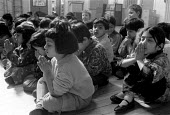 children (mostly Asian) praying at Church of England primary school Nelson Lancashire 1988 - Stefano Cagnoni - 1980s,1988,asian,BAME,BAMEs,black,BME,bmes,child,CHILDHOOD,children,Church,churches,diversity,EDU education,ethnic,ethnicity,female,females,girl,GIRLS,juvenile,juveniles,kid,kids,minorities,minority,m