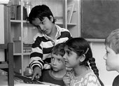 Children using computer at Church of England primary school Nelson Lancashire 25.3.88 - Stefano Cagnoni - 1980s,1988,asian,BAME,BAMEs,black,BME,bmes,CHILD,CHILDHOOD,Children,Church,churches,COMPUTE,computer,COMPUTERS,COMPUTING,diversity,EDU education,ethnic,ethnicity,intelligence,intelligent,juvenile,juve