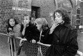 Teenage girls smoking on the eve of leaving school, Liverpool 1988 - Stefano Cagnoni - 1980s,1988,adolescence,adolescent,adolescents,child,CHILDHOOD,children,CIGARETTE,cigarettes,communicating,communication,conversation,dialogue,edu,educate,educating,education,educational,female,females