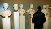 Visitor to the British Museum peruses the Greek and Roman antiquities - Stefano Cagnoni - 2000,2000s,ACE,ACE arts culture,ace culture,artwork,artworks,bust,busts,cities,city,Culture,heritage,holiday,holidays,learning,LFL lifestyle & leisure,marble,museum,MUSEUMS,public services,sculpture,S