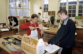 Teacher teaching with student in the carpentry workshop at the College of North East London (CoNEL) - Stefano Cagnoni - 14-01-2000