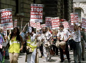 "Jubilee 2000 supporters demonstrate outside the Treasury in Whitehall to tell Gordon Brown to ""stop taking the money"" from the poorest countries in the world. The protest was timed to coincide with th... - Stefano Cagnoni - 06-07-2000"