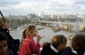 Primary schoolchildren from an inner-city London school riding in one of the capsules on a class visit to the London Eye Millennium Wheel - the wheel is the fourth tallest structure in London and has... - Stefano Cagnoni - 17-02-2000