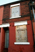 'All materials of value have been removed' - sign on a boarded up council house in the rundown area of Langworthy in Salford. Langworthy is about 1 mile from the dockland area of Salford Quays which h... - Stefano Cagnoni - 20-01-2000