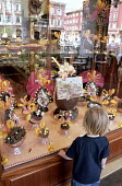 Child ogling easter eggs in a French shop window display - the egg in the centre is priced at 2590 francs, about 250 - Stefano Cagnoni - 12-04-2001