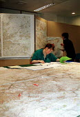 MAFF civil servants plotting further outbreaks of foot and mouth disease on large scale ordnance survey maps as they are telephoned through to the MAFF Emergency Control Centre in Westminster - Stefano Cagnoni - 28-03-2001