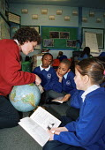 Teacher showing a location to her small reading group in class at St. Mary Magdalene Church of England Primary School in Islington - Stefano Cagnoni - 12-02-2001