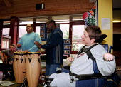 Music workshop for people with learning difficulties held at the Ermine Road Day Centre in Haringey - Stefano Cagnoni - 2000s,2001,access,ACE,ace arts,artwork,artworks,BAME,BAMEs,black,BME,bmes,bound,cities,city,creative,cultural,disabilities,disability,disable,disabled,disablement,diversity,drum,DRUMMERS,DRUMMING,drum