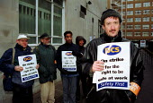 PCS members on the picket line at the Social Security offices in Tavistock Square - striking for the right to be safe at their place of work - Stefano Cagnoni - 2000s,2001,at,communicating,communication,conversation,dialogue,dispute,DISPUTES,industrial action,INDUSTRIAL DISPUTE,jobcentre jobcentres,member,member members,members,offices,PCS,people,picket,picke