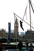 Boy on elasticated tourist attraction on the South Bank opposite the Houses of Parliament - Stefano Cagnoni - 01-04-2002